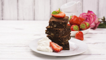 Paleo Brownies with Ganache, Whipped Cream, and Fresh Fruit